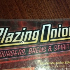 Photo taken at Blazing Onion Burger Company by Shantelle on 8/27/2012