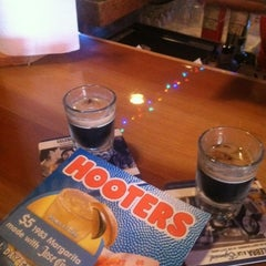 Photo taken at Hooters by Gabriel D. on 2/19/2012