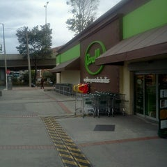 Photo taken at Carulla by Gustavo C. on 7/17/2012