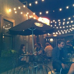 Photo taken at Muddy Waters Bar & Eatery by Andrea on 5/15/2012