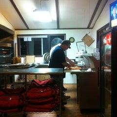 Photo taken at Cabin Pizza by Matt K. on 3/31/2012
