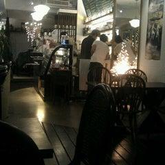 Photo taken at a corner caf'e by Ann H. on 9/13/2011