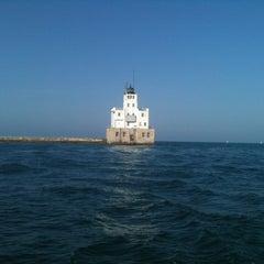 Photo taken at US Coast Guard Lighthouse (aka Milwaukee Breakwater Lighthouse) by Jeffrey D. on 8/3/2012