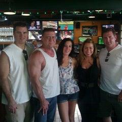 Photo taken at O'Tooles Irish American Grill & Bar by Andrea P. on 7/7/2011