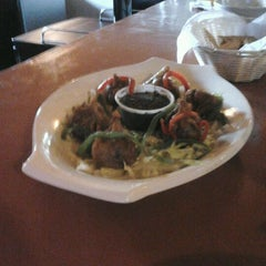 Photo taken at Old Mission Brewery by Juan S. on 4/21/2012