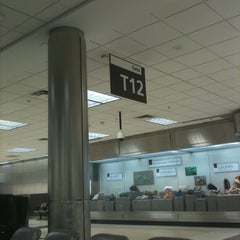 Photo taken at Gate T12 by Javier H. on 1/13/2011