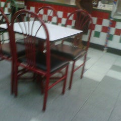 Photo taken at Mario's Pizza Arima by Kendell P. on 11/21/2011