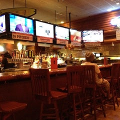 Photo taken at Smokey Bones Bar & Fire Grill by Adilson T. on 3/22/2012