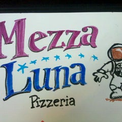 Photo taken at Mezza Luna Pizzeria by Thomas P. on 8/22/2011