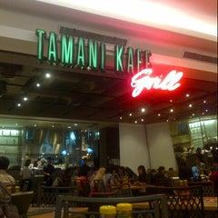 Photo taken at Tamani Kafe Grill by F.Fanie F. on 8/9/2012