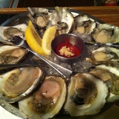 Photo taken at Sea Catch Restaurant & Raw Bar by Julie L. on 7/9/2011