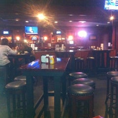 Photo taken at Pokes Bar & Grill by Lewis B. on 10/3/2011