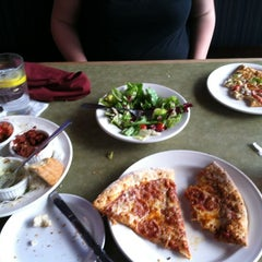 Photo taken at Pizza Lucé by Zoey B. on 4/9/2012