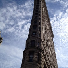 Photo taken at Flatiron Building by Elle M. on 8/26/2012