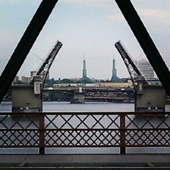 Photo taken at Hawthorne Bridge by Devin A. B. on 7/17/2012