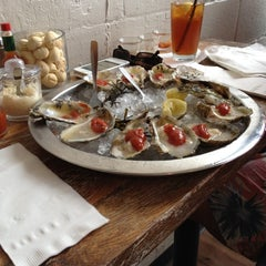 Photo taken at Henlopen City Oyster House by Ed G. on 8/17/2012