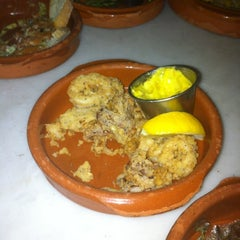 Photo taken at Santos Tapas Bar by Cyrille Z. on 5/24/2012