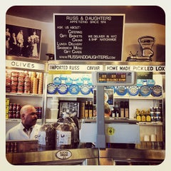 Photo taken at Russ & Daughters by Bobby N. on 3/14/2012