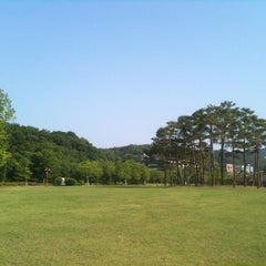 Photo taken at 율동공원 (Yuldong Park) by Yoonseok H. on 7/7/2012