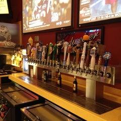 Photo taken at Buffalo Wild Wings Grill & Bar by Derek H. on 2/21/2012
