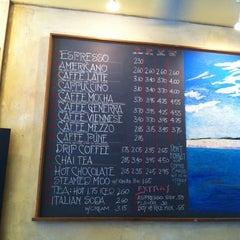 Photo taken at Uptown Espresso by Darren L. on 8/26/2011