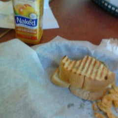 Photo taken at Bruegger's by A M. on 4/2/2011