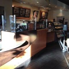 Photo taken at Starbucks by Sam H. on 6/27/2012