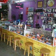Photo taken at Triple Communication by Ricky K. on 8/19/2012