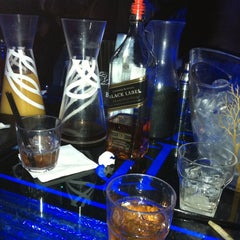 Photo taken at Pure Lounge by Justin V. on 4/14/2012
