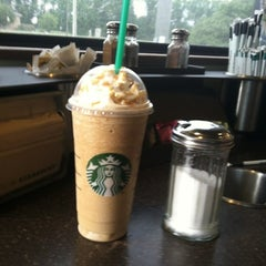 Photo taken at Starbucks by Erin R. on 7/26/2012