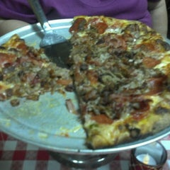 Photo taken at Simonetti's Pizza by Suzanne G. on 12/5/2011
