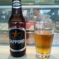Photo taken at Minato Sushi Cafe by Geoff M. on 8/18/2012
