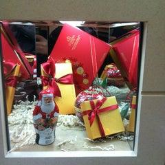Photo taken at Godiva Chocolatier by Leonard C. on 12/18/2011