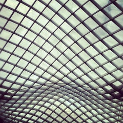 Photo taken at Kogod Courtyard by Geoff D. on 5/20/2012