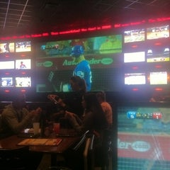 Photo taken at ESPN Zone by Adrian F. on 8/17/2011