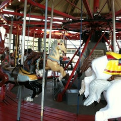 Photo taken at Greenport Antique Carousel by Alexandra on 9/2/2012