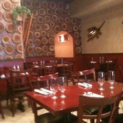 Photo taken at Costanera Restaurant by Emily H. on 3/17/2012