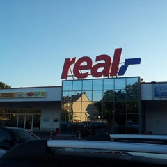 Photo taken at real,- by Ingo K. on 7/23/2012