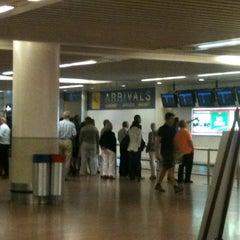 Photo taken at Arrivals (Aankomsten/Arrivées) by Inge P. on 8/10/2012