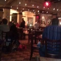 Photo taken at Grotto Ristorante by Elaine E. on 1/16/2012