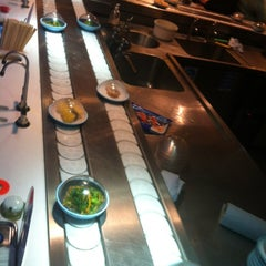 Photo taken at YO! Sushi by Claudio D. on 7/31/2012
