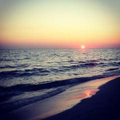 Photo taken at Miramar Beach by Albert C. on 10/24/2011