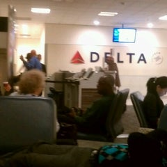 Photo taken at Gate A10 by Shawn M. on 12/22/2011