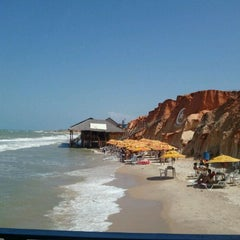 Photo taken at Praia de Canoa Quebrada by Ligia M. on 1/20/2012