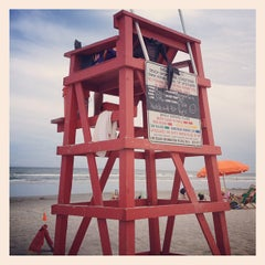 Photo taken at Cocoa Beach by Bill R. on 8/3/2012