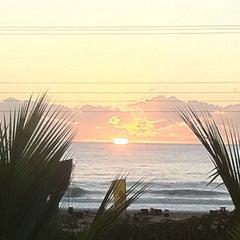 Photo taken at Praia Brava by Tiago M. Garcia on 3/17/2012
