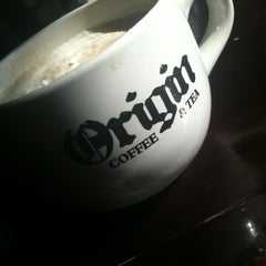 Photo taken at Origin Coffee & Tea by Chris H. on 5/6/2011