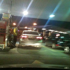 Photo taken at Posto Carrefour (Shell) by Melissa B. on 2/15/2012