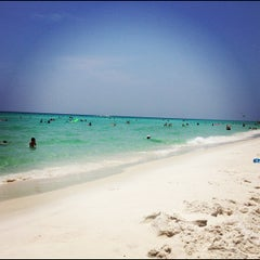 Photo taken at Miramar Beach by Lindsay J. on 7/7/2012