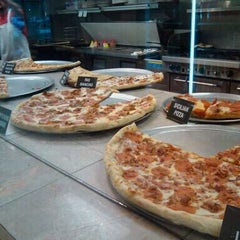 Photo taken at Slice of NY Pizza by Cris M. on 5/18/2011